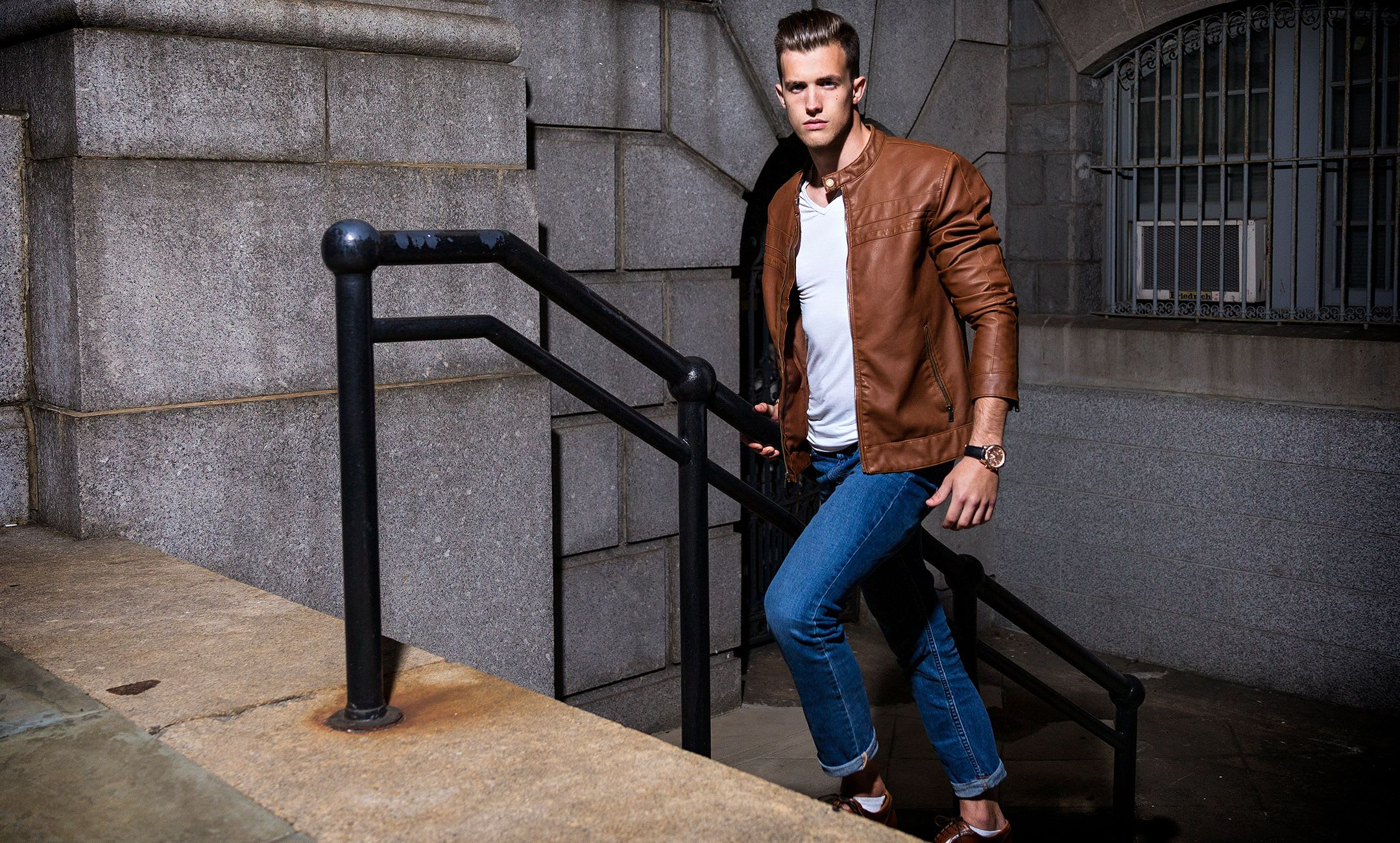 male fashion model walking up the stairs