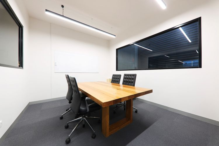 Meeting room office with wooden desk and glass windows