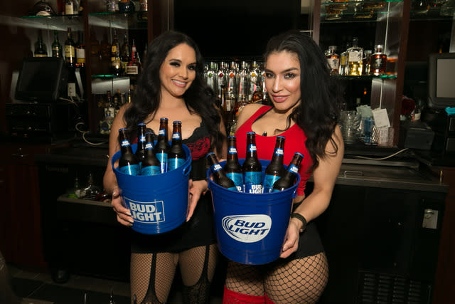 Beautiful servers and beer buckets