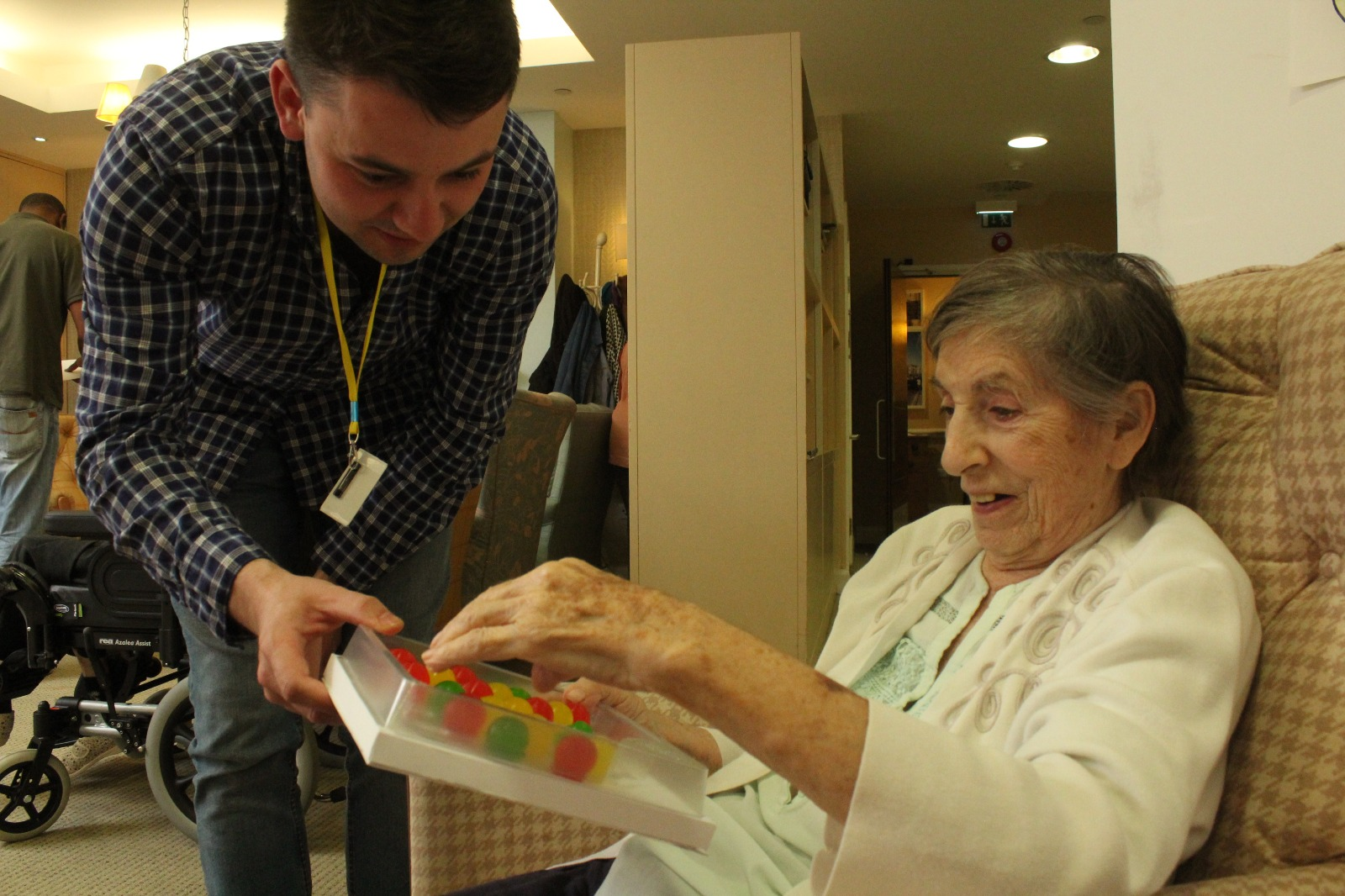 Lady in a care home trying a Jelly Drop