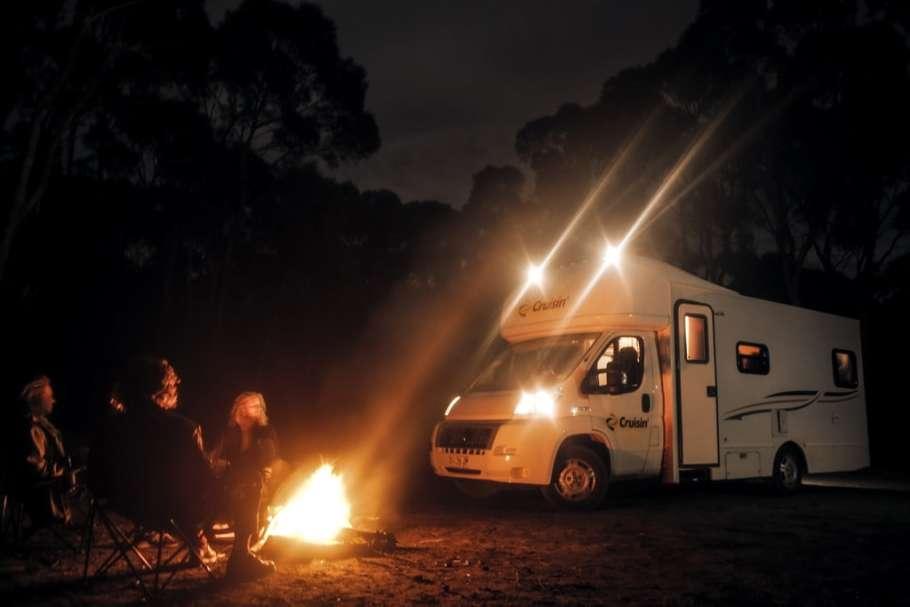 Camp Fire Near a Campervan