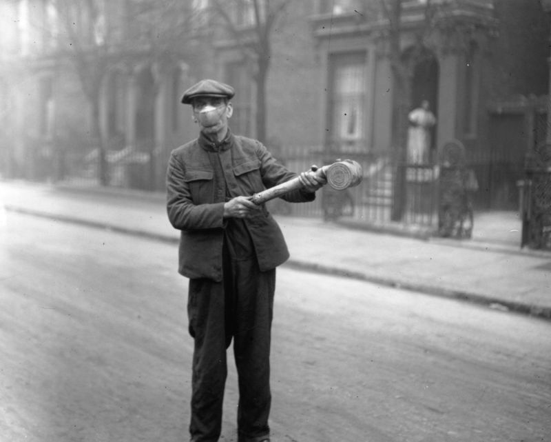 A man preparing 'Anti-flu' spray for buses of the London General Omnibus Co, London, 2nd March 1920.