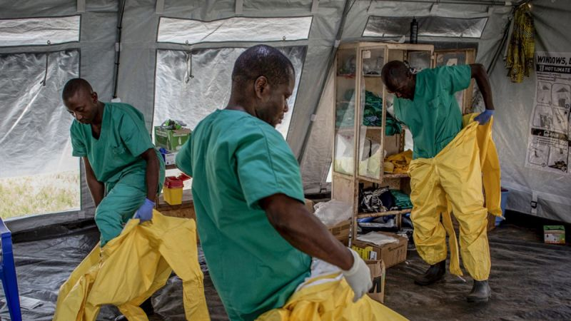 A team of medical workers don protective equipment before entering an Ebola Treatment Center in Beni, the epicenter of the outbreak in the Democratic Republic of the Congo.