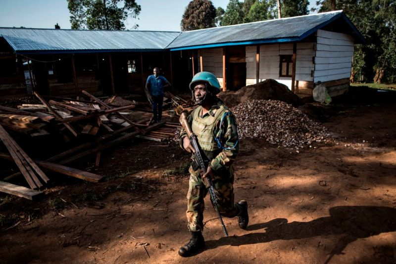 A soldier from the United Nations Organisation Stabilisation Mission in the Democratic Republic of the Congo (MONUSCO), patrols outside an Ebola Treatment Centre (ETC) in Butembo, the epicentre of DR Congo's latest Ebola outbreak, after it was attacked on March 9, 2019.