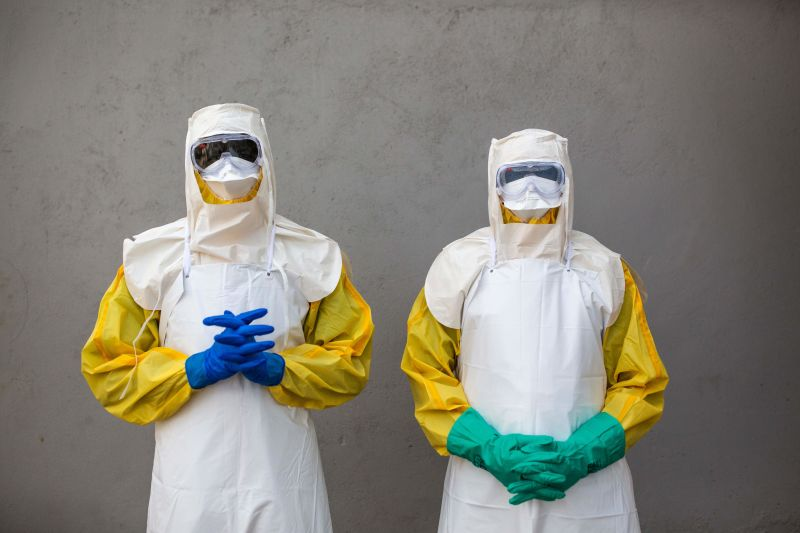 TOPSHOT - Staff from South Sudan's Health Ministry pose with protective suits during a drill for Ebola preparedness conducted by the World Health Organization (WHO) with ALIMA (The Alliance for International Medical Action) and International Medical Corps in Juba, on August 14, 2019, to contain a potential Ebola outbreak in the country.