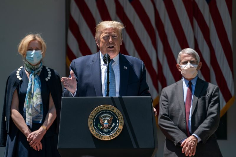 Flanked by White House coronavirus response coordinator Dr. Deborah Birx (L) and Dr. Anthony Fauci (R), director of the National Institute of Allergy and Infectious Diseases, U.S. President Donald Trump delivers remarks about coronavirus vaccine development in the Rose Garden of the White House on May 15, 2020 in Washington, DC.