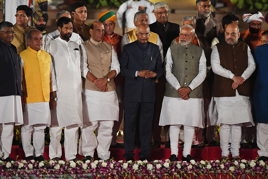 Prime Minister Narendra Modi and cabinet ministers stand with President of India Ram Nath Kovind after taking the oath of office at the President house in New Delhi on May 30, 2019.