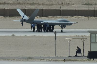 This photo taken on May 30, 2019 shows personnel around a surveillance drone on the runway of the airport in Hotan in China's western Xinjiang region. (GREG BAKER/AFP/Getty Images)