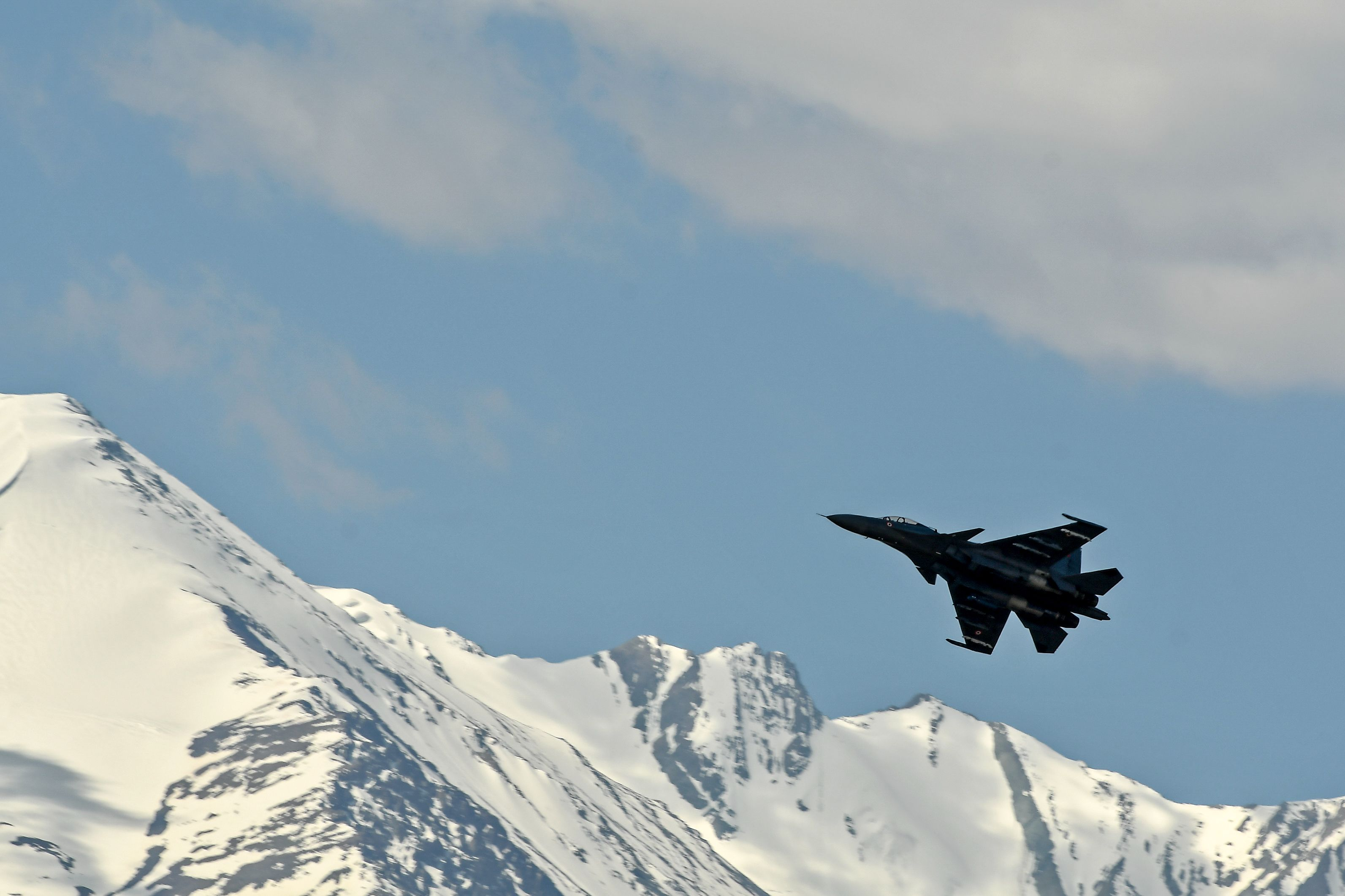 An Indian Air Force aircraft is seen against the backdrop of mountains surrounding Leh, the joint capital of the union territory of Ladakh, on June 27, 2020. (TAUSEEF MUSTAFA/AFP via Getty Images)