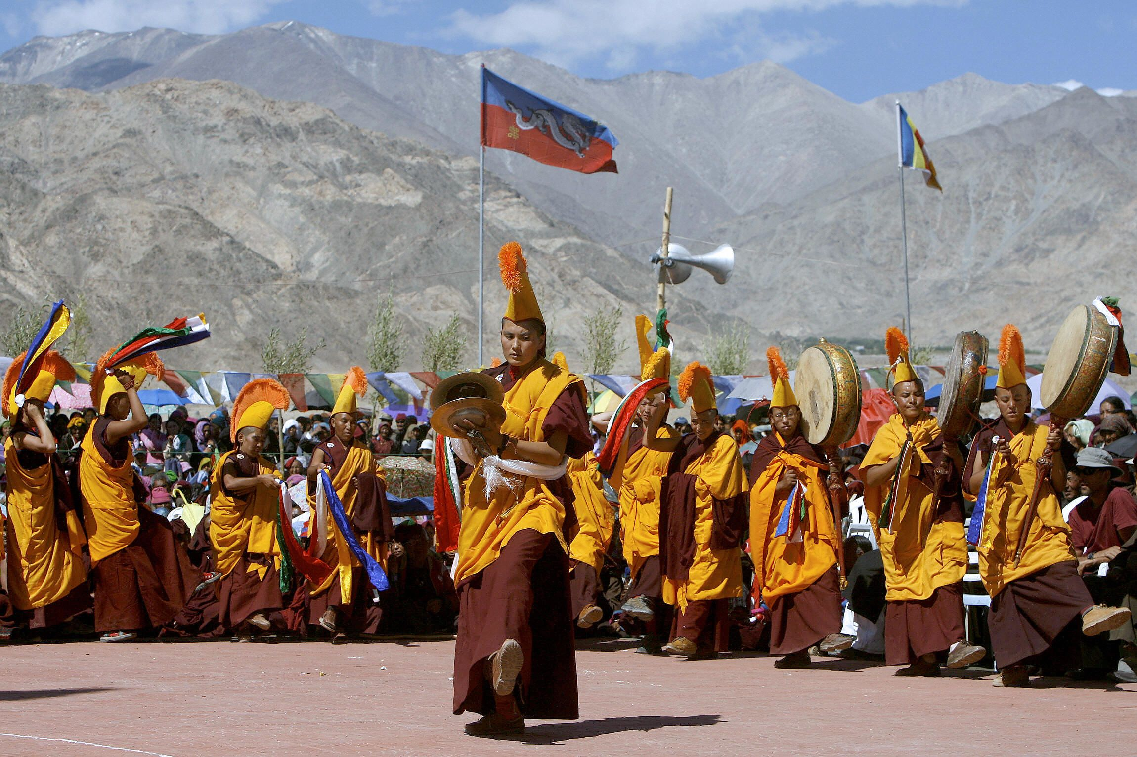 Shey, INDIA: Buddhist nuns perform a rarely performed religious dance called Nga Chham, outside The Naro Photang Puspahari temple in Shey, Some 15 kilometers south of Leh, 19 July 2007. (MANPREET ROMANA/AFP via Getty Images)