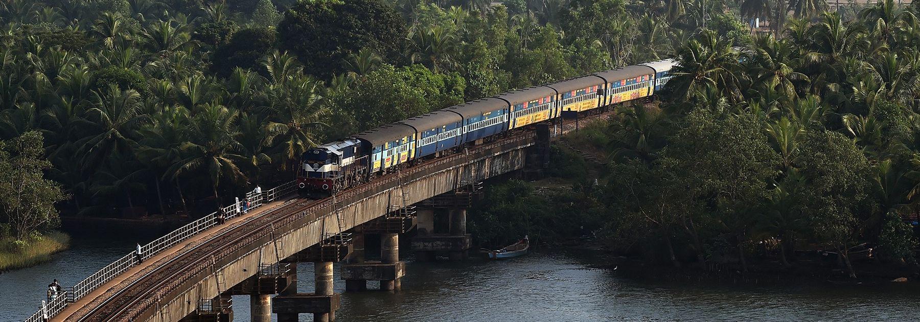 An Indian Railways diesel locomotive carrying a passenger train on Sherawati bridge in Karnataka. (PRAKASH SINGH/AFP/Getty Images)