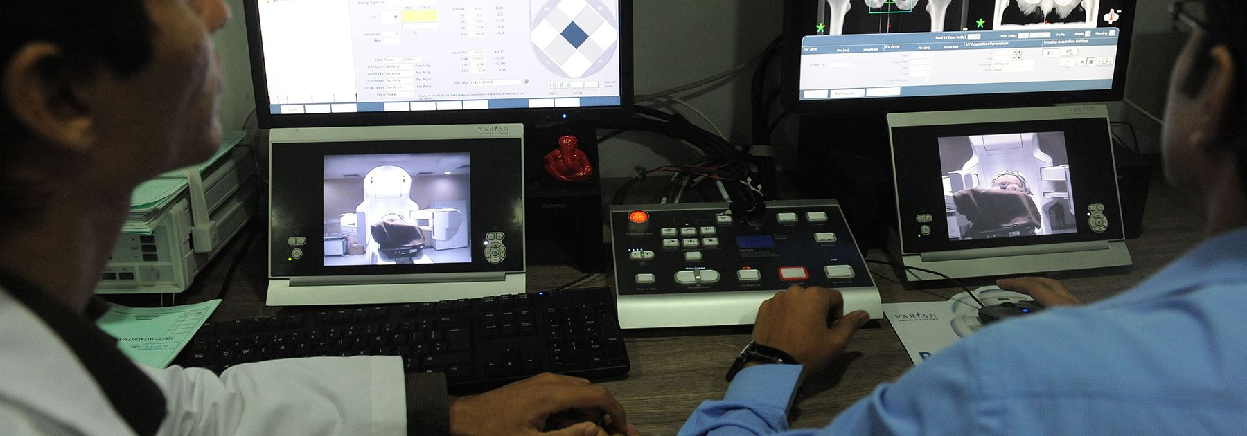 Radiation technicians monitor as a cancer patient lies on India's first True Beam Radiotherapy Technology Linear Accelerator at the Health Care Global (HCG) hospital in Ahmedabad. (SAM PANTHAKY/AFP/Getty Images)