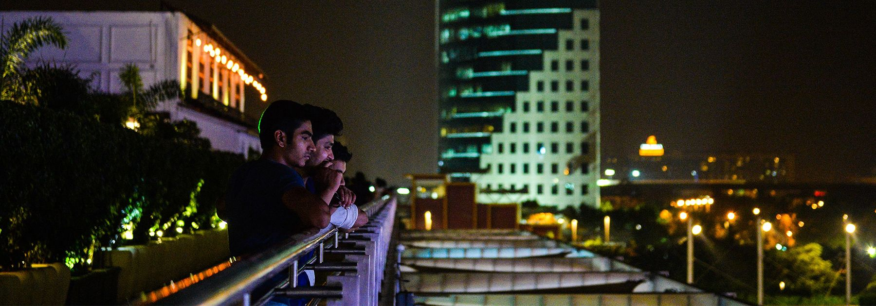 People look over a mall in the DLF Cyber City area of Gurgaon. (CHANDAN KHANNA/AFP/Getty Images)
