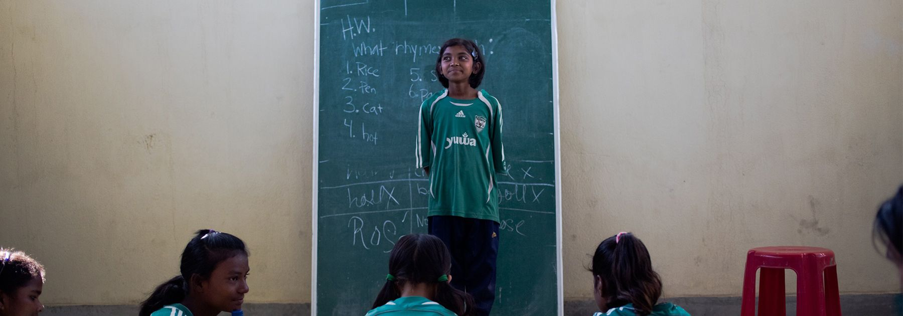 A student, age 11, and member of 'The Rockstars' Yuwa School football training team introduces herself in an English class at the school in Hutup Village. (Rebecca Conway/AFP/Getty Images)