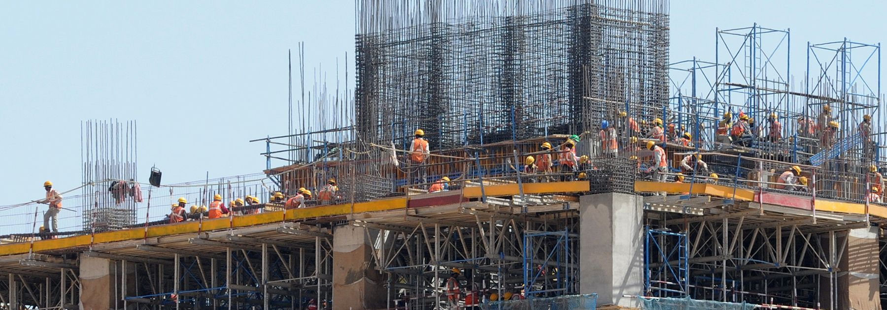 Under construction residential buildings rise into the skyline of Mumbai. (PUNIT PARANJPE/AFP/Getty Images)