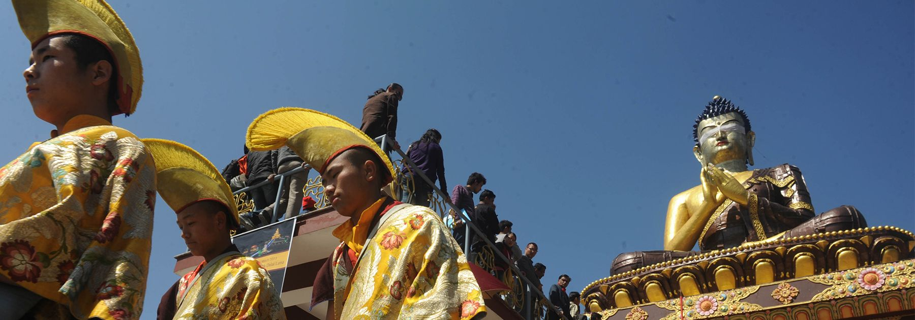 Buddhist monks walk at the 130 foot Lord Buddha statue during the Dzung ceremony as Buddha Park is unveiled on February 25, 2013. (DIPTENDU DUTTA/AFP/Getty Images)