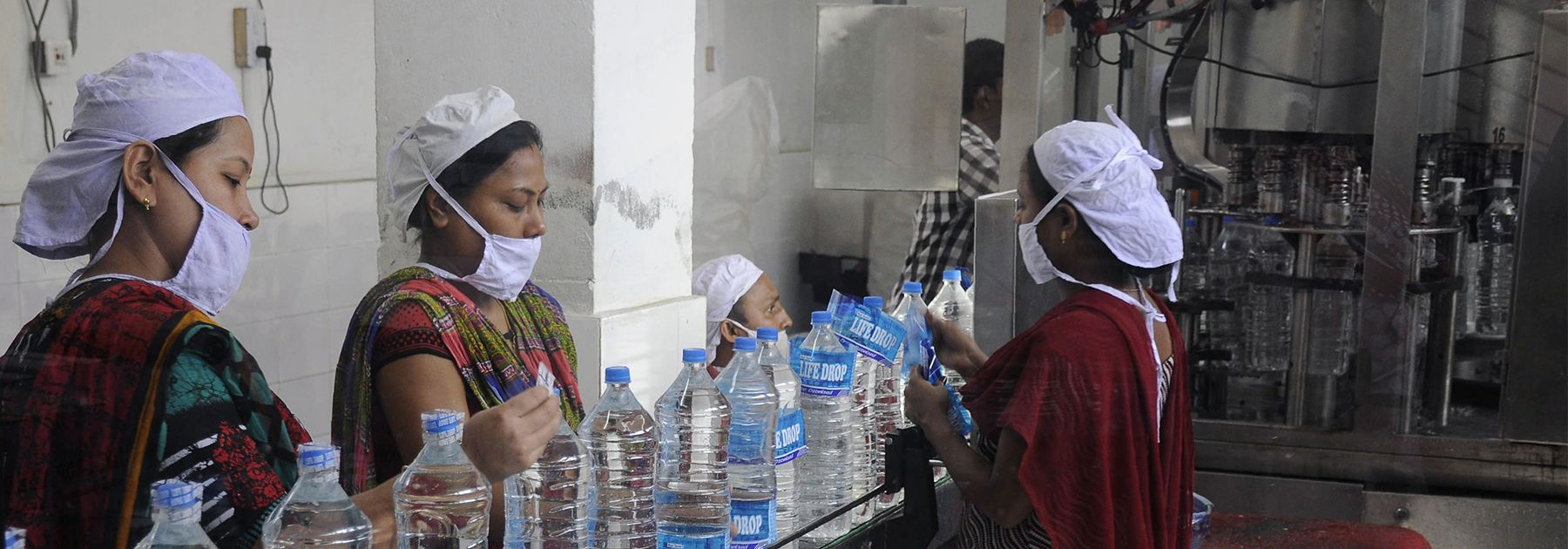 Workers add labels onto bottles of drinking water at a bottling unit on World Water Day in Agartala. (ARINDAM DEY/AFP/Getty Images)