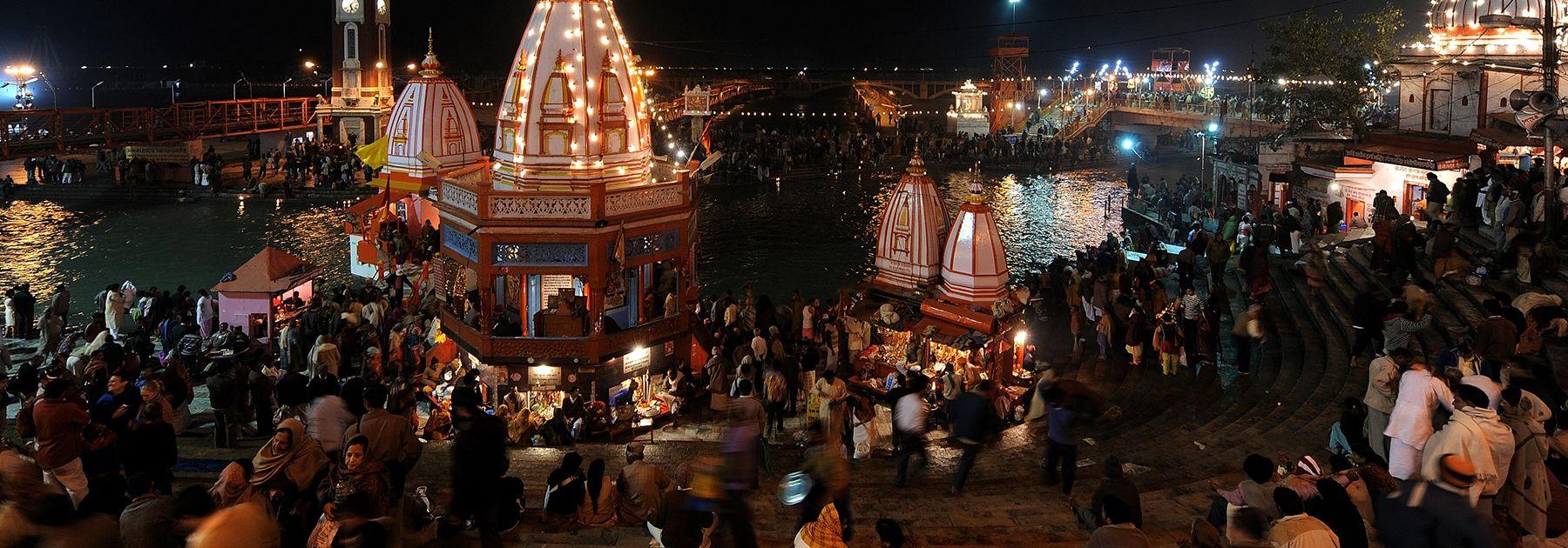Hindu devotees perform evening prayers on the banks of the river Ganges on Makar Sankranti during the Kumbh Mela festival in Haridwar. (MANAN VATSYAYANA/AFP/Getty Images)