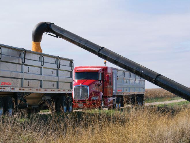 demco grain trailer being loaded in a field