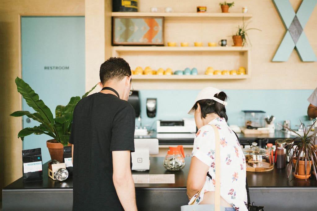 Jordan and Sarah looking at the menu in a coffee shop