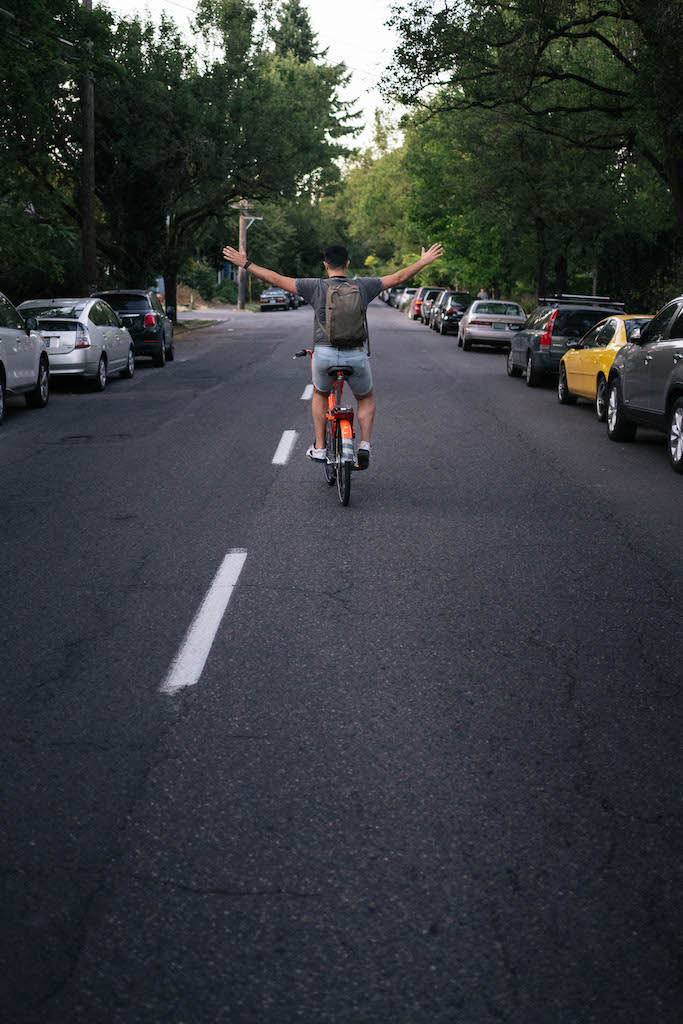 Payam riding a bike with no hands