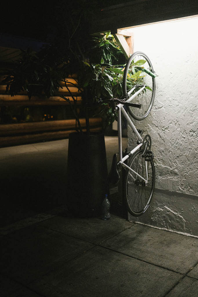 A fixed-gear bike under some bright lights