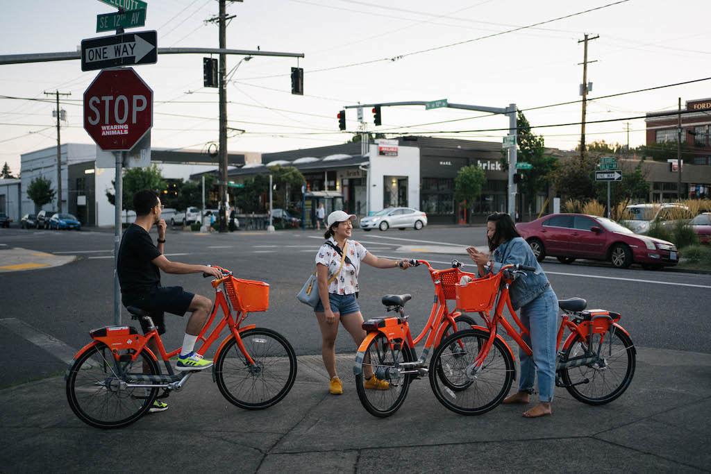 Jordan, Sarah and Sara on red bikes, waiting