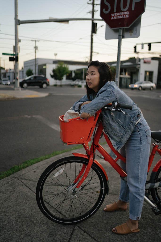 Sara on a red bike