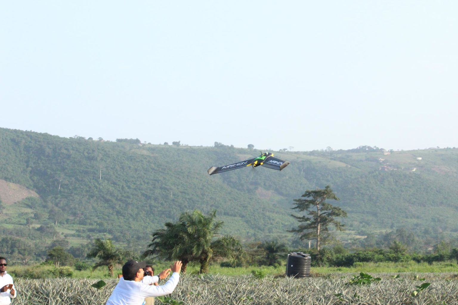 A fixed-wing drone from Airinov flies to map a pineapple field near Accra, Ghana, in October 2016