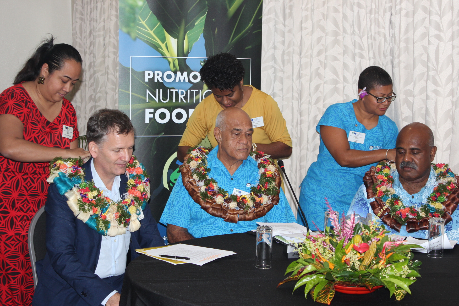Garlanding chief guests of the workshop: From left to right, Mr Christoph Wagner, Head of Cooperation, European Delegation for the Pacific; Howard Politini, Chair Pacific Islands Private Sector Organisation and Sakiusa Tubuna, Regional Coordinator IFAD Pacific