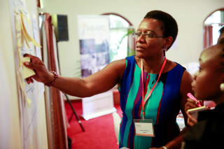 Sarah Mubiru, managing director of Aroma Honey Toffee Ltd, brainstorming at a Gender in Agribusiness Investments for Africa workshop