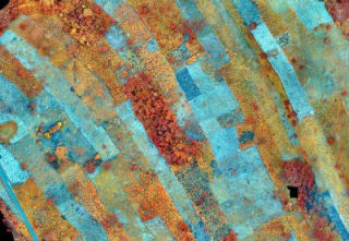 Near-Infrared (NIR) image of small-scale farms in Ghana. The blue colours represent bare soil or soil covered with debris