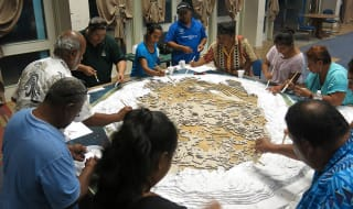 Participants manufacturing a relief model of the island