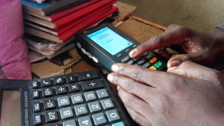 Milambo Maambo's agro-shop use the Zoona mobile transfer platform to supply inputs to smallholder farmers