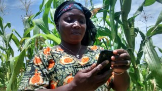 Ensibuuko enables farmers to deposit and withdraw money from their financial cooperatives by mobile phone