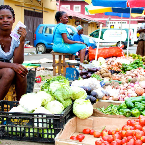 A woman sells vegetables on a street in Malabo, Equatorial Guinea