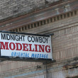 Austin Photo Set: News_Mike_midnight cowboy oriental modeling_feb 2012_sign