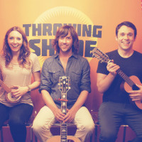 Throwing Shade podcast members Erin Gibson and Bryan Safi with Rhett Miller
