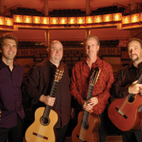 members of LA Guitar Quartet standing in a theater