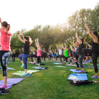 People practicing yoga outside