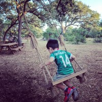 Vista Brewing child on swing fun