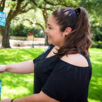 Guest filling a reusable water bottle