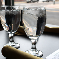 water glasses, glass of water, restaurant table