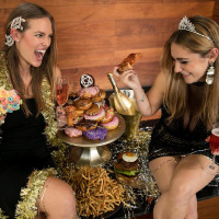 Girls surrounded by food on New Year's Eve