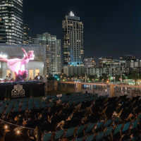 Rooftop Cinema Club Houston night skyline