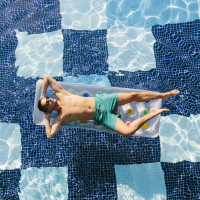 Man floating in a pool