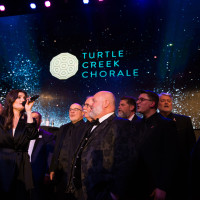 """Idina sings """"Seasons of Love"""" and """"No Day But Today"""" with the Turtle Creek Chorale."""