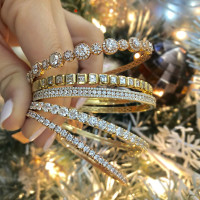 Diamond bracelets in front of Christmas tree