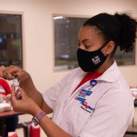 Pharmacy woman holding vaccine covid-19 coronavirus