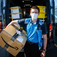 Amazon delivery man box van